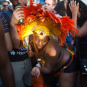 A female performer does her whining moves in the midst of the crowd. The Notting Hill Carnival has been running since 1966 and is every year attended by up to a million people. The carnival is a mix of amazing dance parades and street parties with a distinct Caribbean feel.