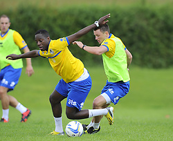 Bristol Rovers' Shaquille Hunter battles for the ball with Bristol Rovers' Ollie Clarke - Photo mandatory by-line: Joe Meredith/JMP - Tel: Mobile: 07966 386802 24/06/2013 - SPORT - FOOTBALL - Bristol -  Bristol Rovers - Pre Season Training - Npower League Two