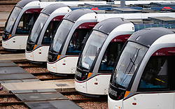 Edinburgh, Scotland, UK. 31 March, 2020. Trams lie idle in depot at Gogar in Edinburgh. Edinburgh Trams are running a reduced service during the coronavirus / Covid-19 pandemic and public lockdown. Iain Masterton/Alamy Live News