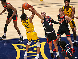 Jan 25, 2021; Morgantown, West Virginia, USA; West Virginia Mountaineers guard Taz Sherman (12) shoots a jumper over Texas Tech Red Raiders guard Kevin McCullar (15) during the second half at WVU Coliseum. Mandatory Credit: Ben Queen-USA TODAY Sports