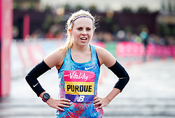 Charlotte Purdue after winning the women's race in the Vitality Big Half in London City Centre.