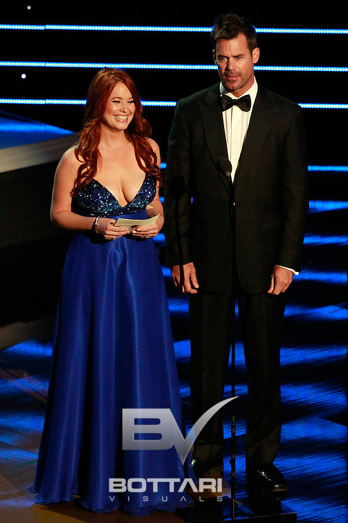 From left, actors Melissa Archer and Tuc Watkins speak onstage during the Daytime Emmy Awards on Sunday June 19, 2011 in Las Vegas. (AP Photo/Jeff Bottari)