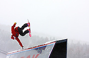 12/20/08 3:37:43 PM -- Breckenridge, CO, U.S.A. -- Snowboarder Yale Cousino of Lincoln, Vt. works a box wall during an open rail jam at the inaugural Winter Dew Tour in Breckenridge, Co. on December 20, 2008. The four-day competition is the first of three stops on the tour that features freeskiing and snowboarding..(Photo by Marc Piscotty / © 2008)