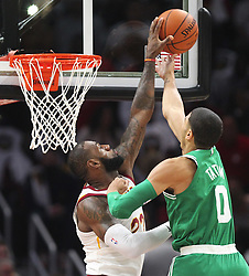 October 17, 2017 - Cleveland, OH, USA - The Cleveland Cavaliers' LeBron James, left, blocks a lay-up from by the Boston Celtics' Jayson Tatum in the first quarter on Tuesday, Oct. 17, 2017, at Quicken Loans Arena in Cleveland. (Credit Image: © Leah Klafczynski/TNS via ZUMA Wire)