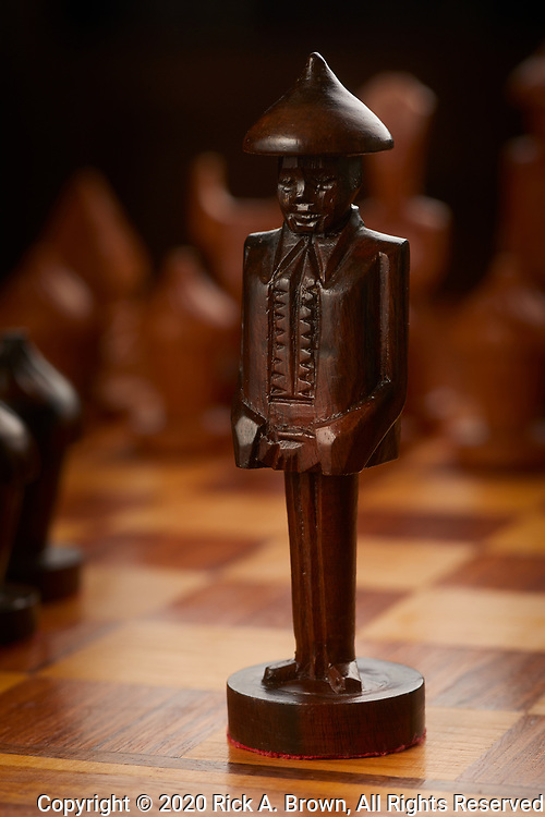 Black king of chess set hand-carved in the Phillipines.