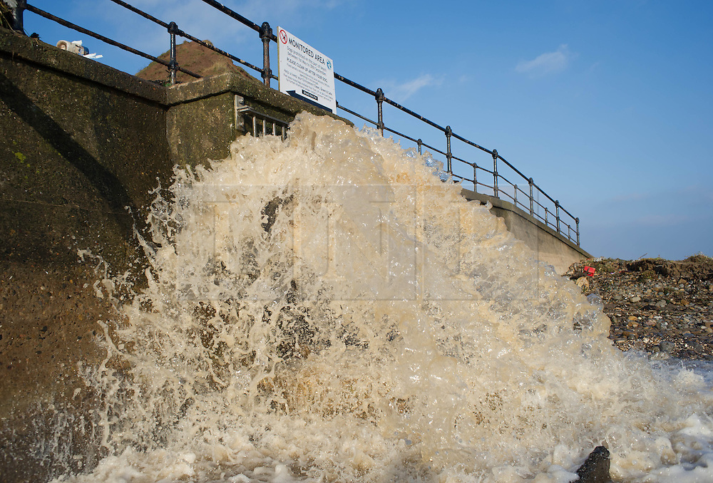 © Licensed to London News Pictures. 07/09/2013<br /> <br /> Saltburn, Cleveland, England<br /> <br /> Rainwater still pours from a run off pipe onto the beach following an evening of torrential rainfall that caused flooding and disruption to Saltburn in Cleveland.<br /> <br /> Photo credit : Ian Forsyth/LNP