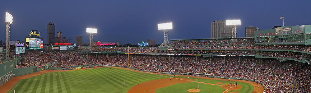 Red Sox Nation at Boston Fenway Park playing against the New York Yankees at Fenway Park. This sport photo shows Boston Fenway Park and Boston skyline with its iconic landmarks like the Prudential center and John Hancock building on a beautiful summer night. <br /> <br /> Boston Fenway Park is the jewel of ballparks and the oldest ballpark in America. The romance began in 1912 when a century of jubilation and heartbreak began.<br /> <br /> Panorama photography prints available at https://juergen-roth.pixels.com/featured/fenway-park-and-boston-skyline-juergen-roth.html<br /> Good light and happy photo making!<br /> <br /> My best,<br /> <br /> Juergen