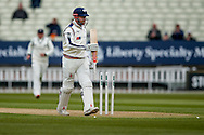 Yorkshire Jonny Bairstow inspects the bottom of his bat after being bowled by Warwickshire Chris Woakes  during the Specsavers County Champ Div 1 match between Warwickshire County Cricket Club and Yorkshire County Cricket Club at Edgbaston, Birmingham, United Kingdom on 24 April 2016. Photo by Simon Davies.