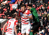 Andy Butler goes for the ball during the EFL Sky Bet League 1 match between Doncaster Rovers and Coventry City at the Keepmoat Stadium, Doncaster, England on 4 May 2019.