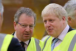 © Licensed to London News Pictures. 29/02/2016. FILES IMAGE: Antrim, Northern Ireland, SENIOR Ulster Unionist's MP Danny Kinahan (left) seen here beside Boris Johnson during a tour of a plant in Antrim,  Northern Ireland. Local media today (March 9th, 2016) have reported that the Ulster Unionist MP Danny Kinahan received almost £23,000 in expenses to cover rent and rates for one of his constituency offices while an MLA in expenses from Stormont to pay rent on a property owned by a party colleague, Adrian Cochrane-Watson. Photo credit : Paul McErlane/LNP