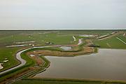 Nederland, Noord-Holland, Gemeente Zijpe, 28-04-2010; Pettemer Zeewering en Hondsbossche zeewering, gezien naar de Noordzee. De zeewering is aangelegd als zeewering nadat de oorsrponkelijke duinen weggeslagen waren. Middenplan de Vereenigde Harger- en Pettemerpolder  met de Oude Schoorlse Zeedijk. De bochten in deze oude dijk duiden op vroegere dijkdoorbraken (wielen), rechts van de dijk de Abtskolk. .Pettemer and Hondsbossche seawall seen in the direction of the North sea. The seawall was built after the primal dunes were washed away. Foreground, the United Harger Pettemer Polder and the Old Schoorlse Zeedijk (sea dike). The curves in this old dyke indicate earlier breaches resulting in small pools, such as the Abtskolk. .luchtfoto (toeslag), aerial photo (additional fee required).foto/photo Siebe Swart