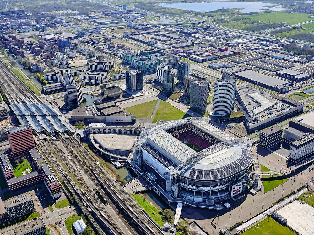 Nederland, Noord-Holland, Duivendrecht; 17-04-2021; ArenA-gebied met Ajax stadion Arena, nu  Johan Cruijff Arena  (JohanCruijffArena). Links NS station Bijlmer Arena.<br /> ArenA area with Ajax stadium Arena, now Johan Cruijff Arena (JohanCruijffArena). Left Bijlmer Arena railway station.<br /> luchtfoto (toeslag op standaard tarieven);<br /> aerial photo (additional fee required)<br /> copyright © 2021 foto/photo Siebe Swart