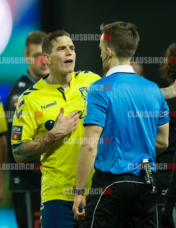 01-03-2015, Broendby, Denmark: A frustrated Daniel Agger of Broendby IF in discussion with referee Kenn Hansen during the Alka Superliga match between Broendby IF and FC Midtjylland at Broendby Stadion. (Photo by Claus Birch).