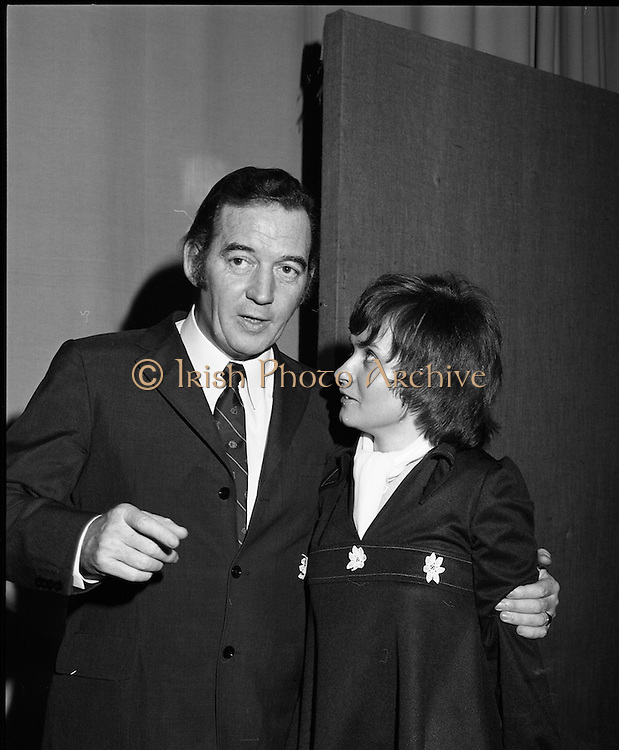 Classified Telephone Girl of the Year..1972..18.12.1972..12.18.1972..18th December 1972..The Area Final Ireland of the Classified telephone Girl of the year 72/73 was held in the Telecommunications Centre, Booterstown Ave. The winner will go forward to the next round at The Grand Hotel,Manchester in February next..The competition was organised by The Irish Times..The contestants were:.Ms Kathy Bannon, Farming Life, Belfast..Ms Carol Budd, Evening Herald,Dublin..Ms Dorothy Gough,Irish Field,Dublin..Ms Linda Hanna,News Letter,Belfast..Ms Susan Harrigan,Sunday News,Belfast..Ms Sophie Kelleher,The Cork Examiner..Ms Marie O'Callaghan,Evening Echo,Cork..Ms Bernadette O'Neill,Irish Independent,Dublin..Ms Rose O'Riordan,Irish Times,Dublin..Ms Pat O'Connell,Belfast Telegraph...Image of the compere,Mr Bunny Carr,with supervisor Ms Valerie Jackson discussing the studio arrangements for the competition contestants.