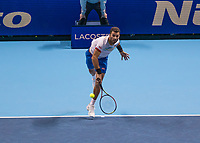 Tennis - 2019 Nitto ATP Finals at The O2 - Day Two<br /> <br /> Doubles Group Max Mirnyi: Kevin Krawietz (GER) & Andreas Mies (GER) Vs. Jean-Julien Rojer (NED) & Horia Tecau (ROM)<br /> <br /> Horia Tecau (ROM) serving <br /> <br /> COLORSPORT/DANIEL BEARHAM