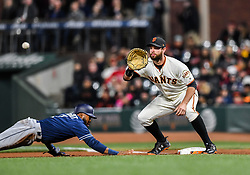 April 30, 2018 - San Francisco, CA, U.S. - SAN FRANCISCO, CA - APRIL 30: San Francisco Giants First base Brandon Belt (9) attempting to tag out San Diego Padres Outfield Manuel Margot (7) during the San Francisco Giants and San Diego Padres game on April 30, 2018 at AT&T Park in San Francisco, CA. (Photo by Stephen Hopson/Icon Sportswire) (Credit Image: © Stephen Hopson/Icon SMI via ZUMA Press)