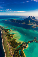 Aerial view showing the coral reef and the lagoon, Bora Bora, French Polynesia.