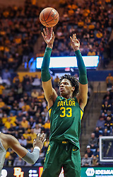 Mar 7, 2020; Morgantown, West Virginia, USA; Baylor Bears forward Freddie Gillespie (33) shoots a jumper during the first half against the West Virginia Mountaineers at WVU Coliseum. Mandatory Credit: Ben Queen-USA TODAY Sports