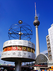 Historic world clock in former East Berlin with Television Tower  to rear at Alexanderplatz in Germany