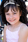 Smiling young girl age 4 wearing a tiara. Grand Old Day Festival. St Paul Minnesota MN USA