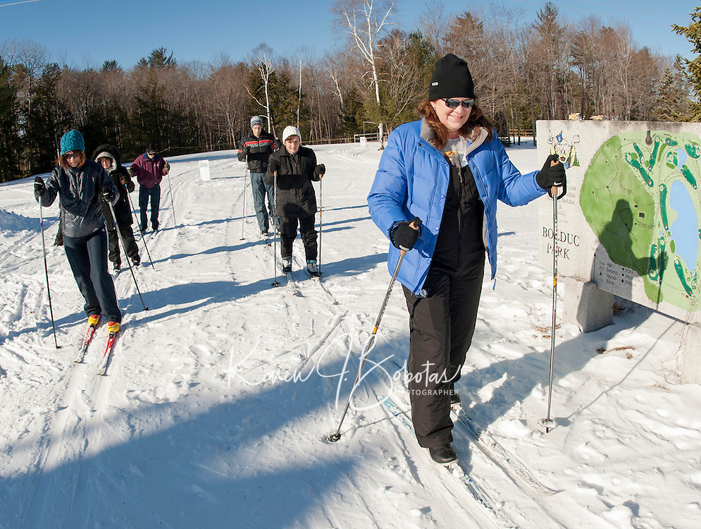 Cheri Palanchian of Gilford starts out on the cross country trails at Bolduc Park for the first of a four week lesson program on Saturday morning. (Karen Bobotas/for the Laconia Daily Sun)