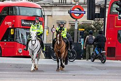 © Licensed to London News Pictures. 21/01/2021. London, UK. Mounted police patrol Hyde Park Corner today. Police continue to patrol parks across the capital while members of the public wrapped up against the wind and enjoy a walk during lockdown. Today, Prime Minister Boris Johnson warned that it was too early to know if Covid-19 restrictions would be lifted in spring or even summers as infections continue to spread throughout out the capital and the rest of the UK. Photo credit: Alex Lentati/LNP