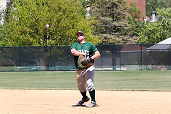 11 May 2013: Kevin Callahan tosses the ball to Matt Hart coming from the mound to cover 1st base during an NCAA division 3 College Conference of Illinois and Wisconsin (CCIW) Pay in Baseball game during the Conference Championship series between the North Park Vikings and the Illinois Wesleyan Titans at Jack Horenberger Stadium, Bloomington IL