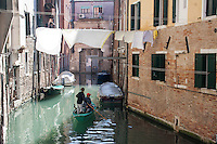 in the jews ghetto in venice. particular with boat on channel and laundry lines above the channel