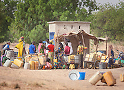 The local people of Waza village queue for water from a well, near the entrance to Waza National Park, in the north of Cameroon