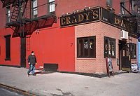 A man in the autumn of his life rambles toward some autumn warmth at Brady's; 2nd Avenue and 82nd street, New York City.