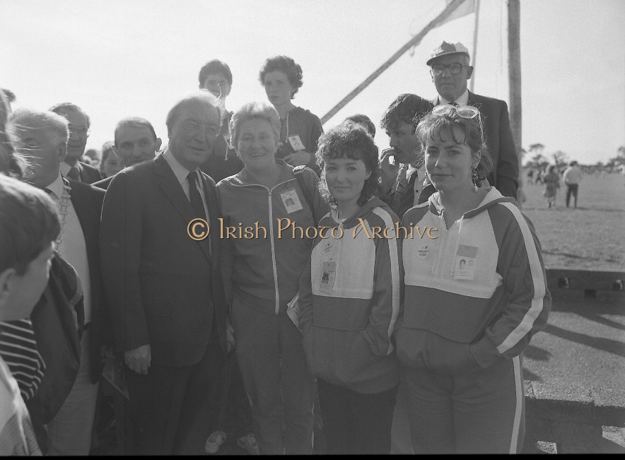 Charles Haughey Visits The Community Games. (T5)..1989..03.10.1989..10.03.1989..3rd September 1989..An Taoiseach, Charles Haughey TD,accompanied by Mr Frank Fahey, TD, Minister of State with responsibility for Youth and Sport attended the Twentieth National Finals of the Community Games at Mosney,  Co.Meath yesterday...Picture shows An Taoiseach, Charles Haughey TD,meeting some of the mentors who attended the Community Games in Mosney.
