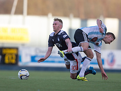 Falkirk's Craig Sibbald gets kicked by Hearts Billy King. <br /> Falkirk 0 v 3 Hearts, Scottish Championship game played 21/3/2015 at The Falkirk Stadium.