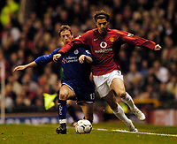 Photo. Jed Wee.Digitalsport<br /> Manchester United v Leicester City, FA Barclaycard Premiership, Old Trafford, Manchester. 13/04/2004.<br /> Manchester United's Christiano Ronaldo (R) tries to get away from Leicester's Steffen Freund..