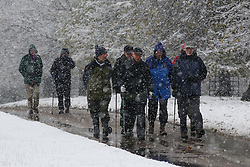 © Licensed to London News Pictures. 09/11/2016. Ripon, UK. Ramblers brave the heavy snowfall at Fountains Abbey near Ripon in North Yorkshire. The Met Office has issued a severe weather warning as Scotland and much of the North of England has seen heavy snowfall. Photo credit : Ian Hinchliffe/LNP
