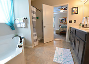 A view from the walk-in closet, through the master bathroom and into the master bedroom. Sheridan and Rikki Glen are At Home in their Tanglewood subdivision home in Caseyville, IL on Wednesday January 16, 2019. <br /> Photo by Tim Vizer