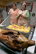 Several of the stalls in the Santa Carolina Market in Quito, Ecuador specialize in roasted pig. (Supporting image from the project Hungry Planet: What the World Eats.)