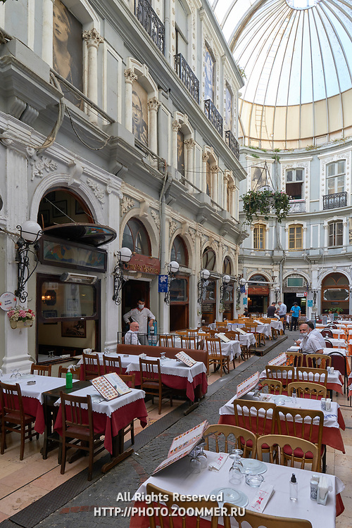 Tables of restaurants in famous Cicek Pasaji, Istiklal street, Istanbul, Turkey
