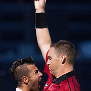 Mehrshad Momeni confronts the referee as he is booked during a USL Pro match between the Pittsburgh Riverhounds vs. Orange County Blues Football Club at Highmark Stadium in Pittsburgh, Pennsylvania. August 8, 2014.