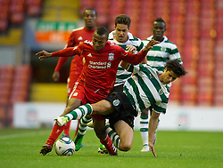 LIVERPOOL, ENGLAND - Wednesday, August 17, 2011: Liverpool's Toni Brito De Silva in action against Sporting Clube de Portugal's Joao Teixeira during the first NextGen Series Group 2 match at Anfield. (Pic by David Rawcliffe/Propaganda)