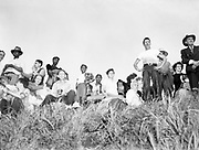 Y-480530-06.  Survivors gather on high ground to watch the destruction of Vanport. May 30, 1948.