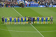 Both sets of players stand together in the centre circle before k/o. in a mark of respect to the recent Paris attacks. Barclays Premier league match, Chelsea v Norwich city at Stamford Bridge in London on Saturday 21st November 2015.<br /> pic by John Patrick Fletcher, Andrew Orchard sports photography.