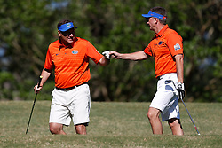 Dan Mullen and Judd Davis celebrate during the Chick-fil-A Peach Bowl Challenge at the Oconee Golf Course at Reynolds Plantation, Sunday, May 1, 2018, in Greensboro, Georgia. (Paul Abell via Abell Images for Chick-fil-A Peach Bowl Challenge)