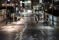 Edinburgh, Scotland, UK. 31 December 2020. Scenes of empty streets at night on Hogmanay in Edinburgh City Centre.Pre Covid-19 pandemic , the city was famous for its street entertainment on New Year's Eve and attracted many thousands of tourists every year to enjoy the New Year celebrations. Iain Masterton/Alamy Live News