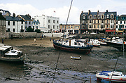 Boats in harbour at low tide, Ilfracombe, north Devon, England, UK 1970s - Royal Britannia Hotel