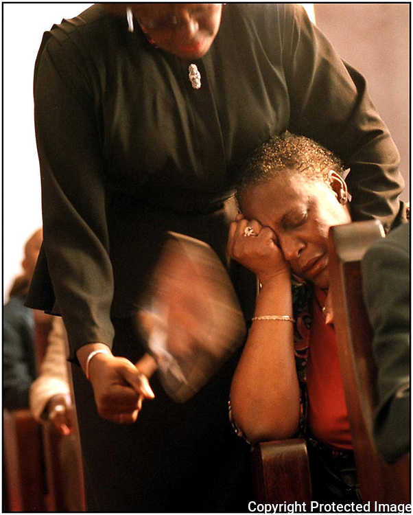 Barbara Williamson was overcome with emotion as her grandson sang during a Sunday morning church service, but found comfort from her friend, Cornelia White.