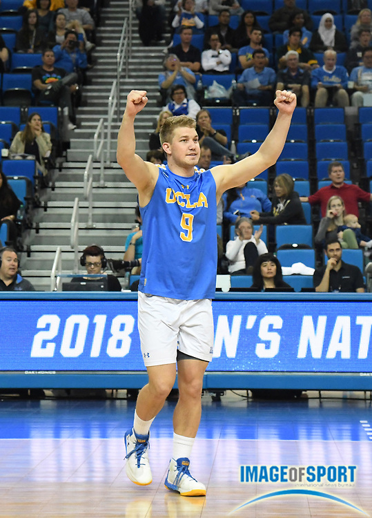 UCLA Bruins libero JT Hatch aka J.T. Hatch celebrates during the opening round game of the NCAA college volleyball championship against the Harvard Crimson  in Los Angeles, Tuesday, May 1, 2018. UCLA defeated Harvard 23-25, 25-21, 25-11, 25-21.