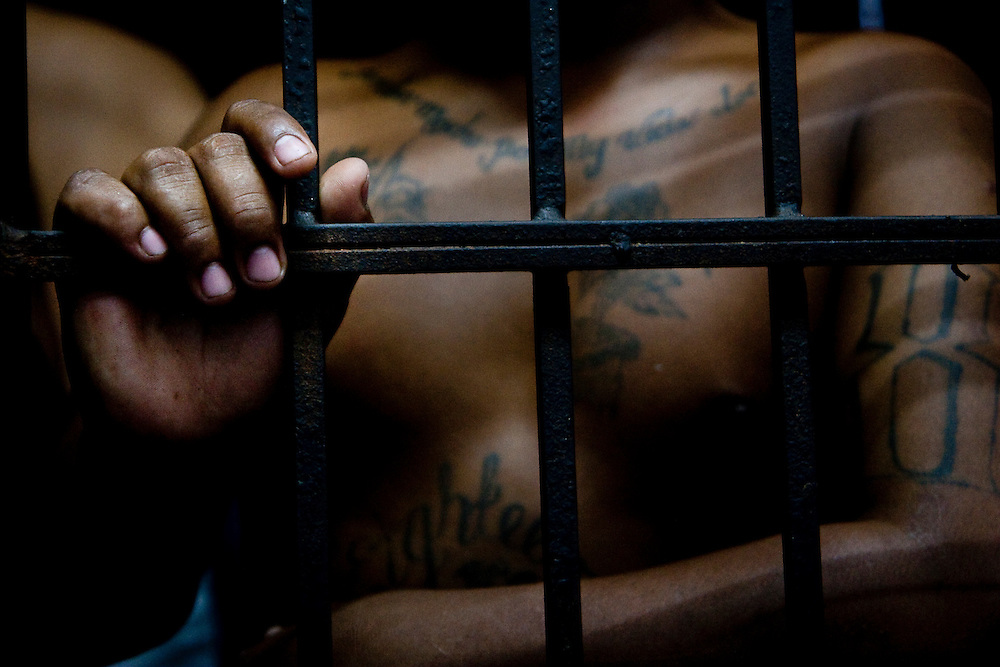 Eduardo in an 18th Street jail cell  in the Ilopango barrio, one of San Salvador's most violent.  This is his  34th birthday and  he says the 10th time he has  been put in jail without charges.  He was deported from the states in 1994 and served 4 years in 2000 for armed robbery.  He says he is trying to move on from the Maras to raise his daughter, but it is difficult.  He was put in jail for being for other members of 18th street.  Even if a Mara stops doing activities with gangs, the relationships made in the gang last for ever.