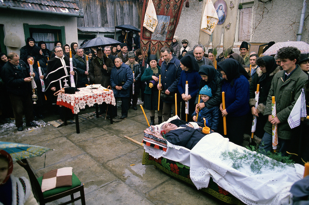 A rural family funeral in Romania in 1989 during the troubled days of the end of the Ceausesau regime.  Photograph by Terry Fincher
