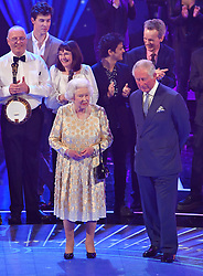 Queen Elizabeth II and the Prince of Wales on stage at the Royal Albert Hall in London during a star-studded concert to celebrate the Queen's 92nd birthday.