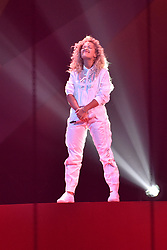 EDITORIAL USE ONLY.<br /><br />Rita Ora performs on stage at the Brit Awards at the O2 Arena, London.